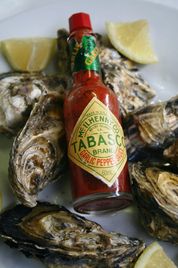 Fresh oysters with lemon and tabasco served during the summer at the Hermanuspietersfontein Market.