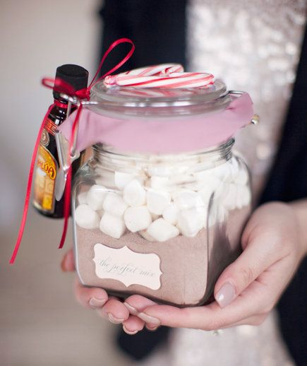 This hot cocoa jar requires a bit of crafting, but the result is so cute it'll be worth the extra effort. Begin by scooping cocoa mix into each jar, followed by peppermint squares and a spoonful of mini marshmallows. Use pretty pink fabric to make the ruffled covers, then tape on a label, add candy cane hearts, and attach a mini bottle of Kahlua for a fun, boozy twist. These would be adorable for Valentine's Day, as well.