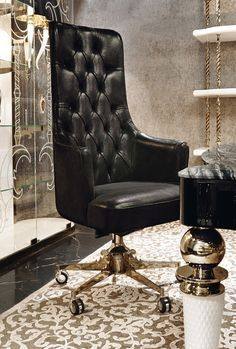 Classical black leather with golden details office chair. Classic Home Office Room. With elegant furniture contrasting with the nude color palette. www.bocadolobo.com #bocadolobo #luxuryfurniture #exclusivedesign #interiodesign #designideas #homeofficedecorideas #leather #classic #goldendetails #luxurychair