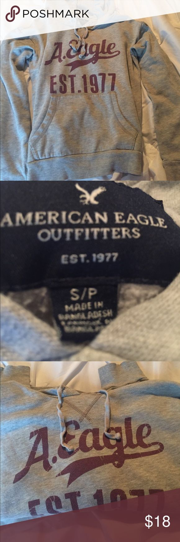 American Eagle Sweatshirt Super comfy sweatshirt to throw over some clothes. Great conditions as it started only warn a few times. Grey with maroon writing. American Eagle Outfitters Tops Sweatshirts & Hoodies