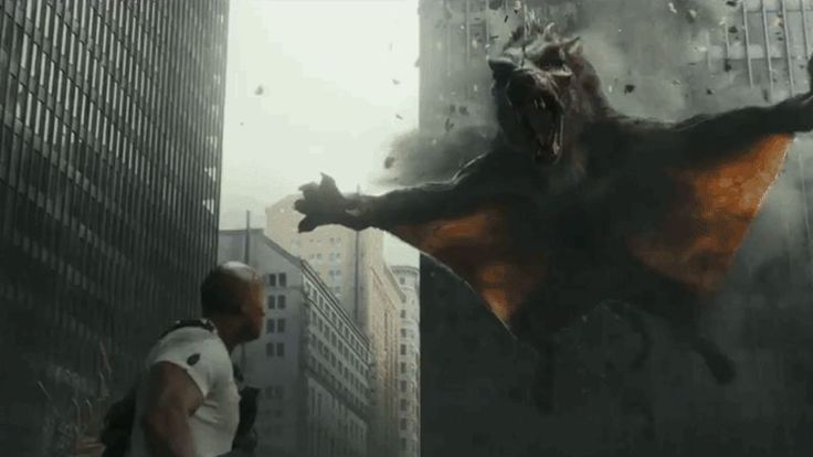 Worried that skyscraper-tall albino gorillas and cruise ship-sized crocodiles wouldn't be enough of a box office draw, the second trailer for Rampage reveals that Dwayne Johnson will also be battling rage-filled wolves who've mutated into some kind of giant flying squirrel.
