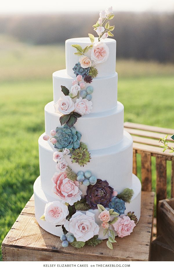 Beautiful white wedding cake with feminine earth color foliage and flower detail for a beautiful, unique spring wedding.