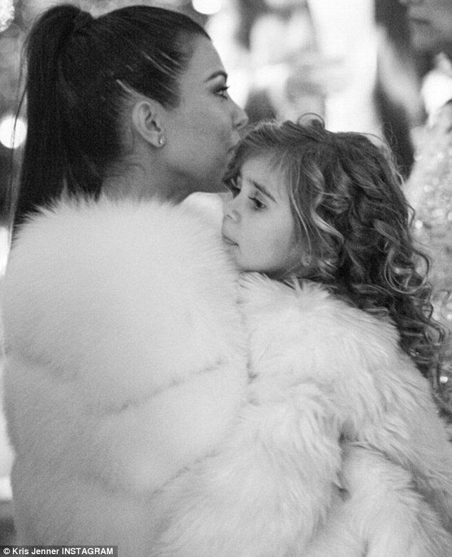 Fur-ever love: Kris Jenner shared a black and white snapshot of Kourtney and Penelope from her Christmas Eve bash on Saturday