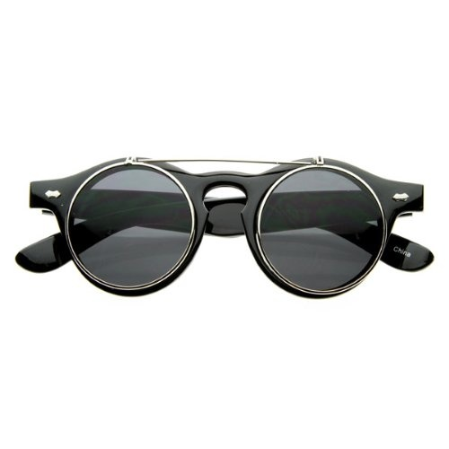 Retro steampunk inspired glasses that feature flip up lenses and keyhole nose bridge. Extremely unique design that are sure to stand out and make a statement. Made with an acetate based frame, metal hinges, and polycarbonate lenses.