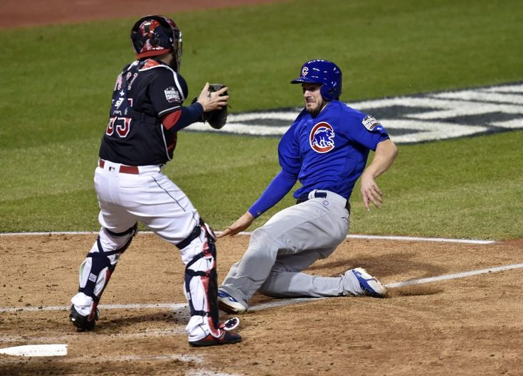 Chicago Cubs third baseman Kris Bryant (17) scores a run past Cleveland Indians catcher Roberto Perez (55) in the fourth inning in game seven of the 2016 World Series at Progressive Field. Photo by David Richard/USA TODAY Sports