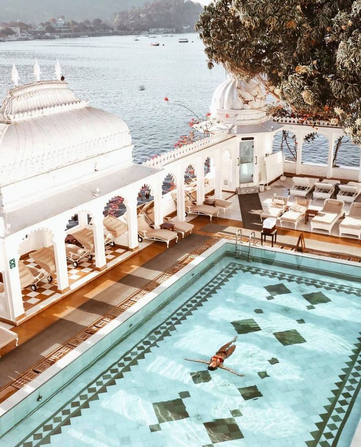 A floating palace made of pure marble sits in the middle of a lake in India, just outside Udaipur - Check out our other 36 other bachelorette party ideas!   Photo: Emily Hutchinson