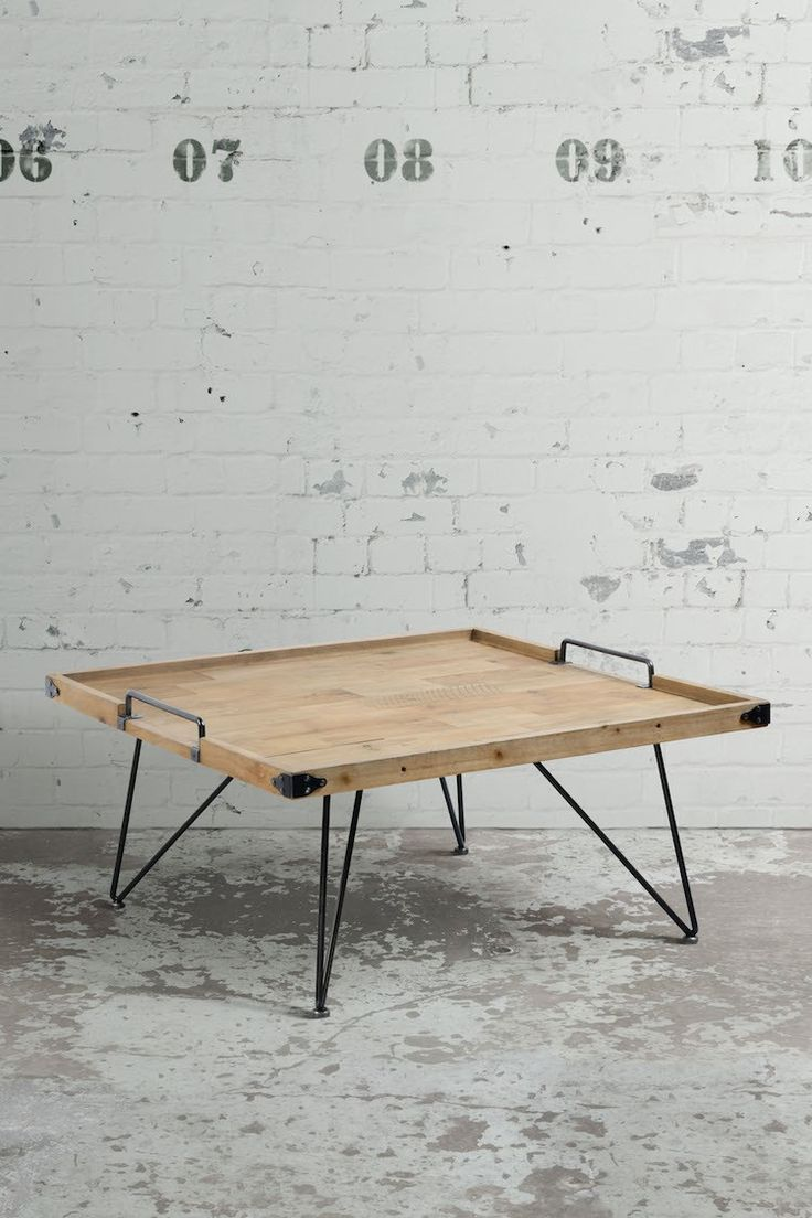 This coffee table boasts useful handles that makes it both stylish and practical.
