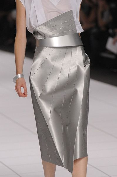 Issey Miyake at Paris Fashion Week Spring 2014 | Love the sleek chrome design on this skirt. ~VELOCE www.velocejewelry.com