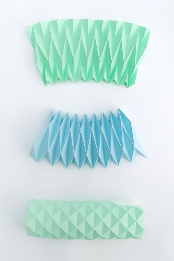 Accordion paper folding // Candle holders would have been a good idea for an accordion photo booth prop