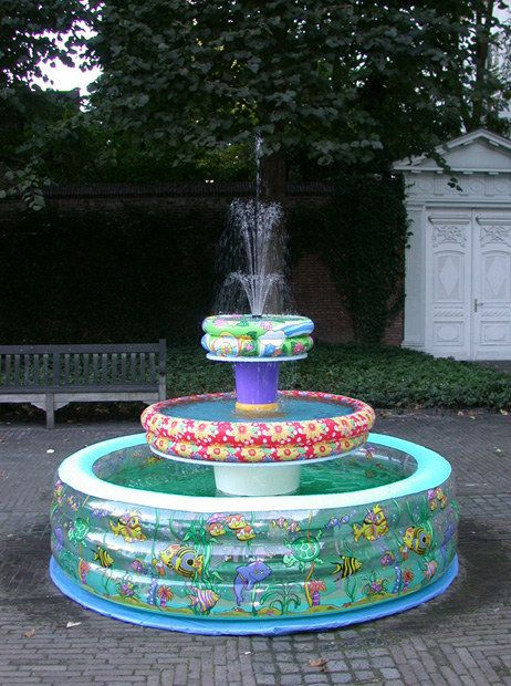 Make an inflatable pool fountain.   37 Ridiculously Awesome Things To Do In Your Backyard This Summer