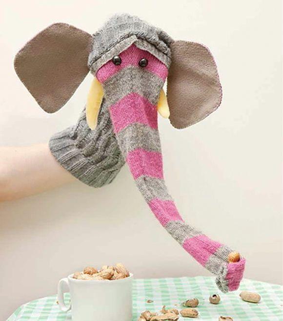Zo een lange sok vullen met reststof als slurf? en dan een masker er achter maken, dus niet hetzelfde als deze... maar van vilt.