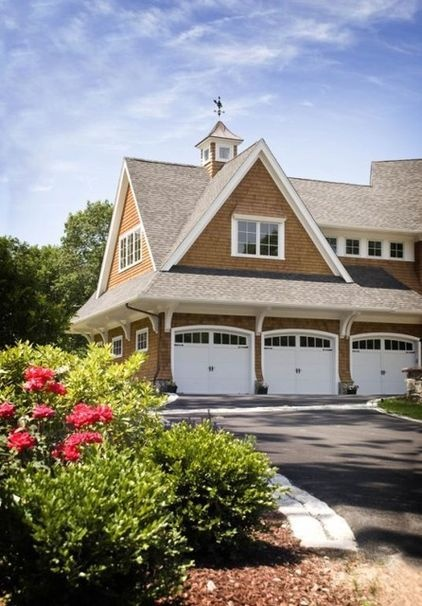 traditional exterior by McKay Architects  The right garage doors can make a big difference.