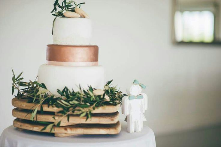 Wedding cake eith 2 bottom fake layers,  sprayed with copper to suite the theme,  rounded off with some olive branches