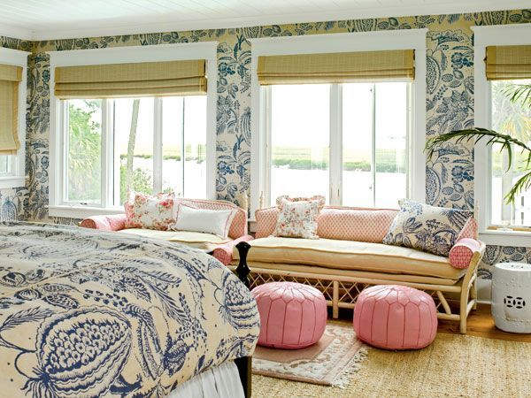 bedroom in dream New England seaside cottage with iconic Manuel Canovas blue & white melon print with pink accents