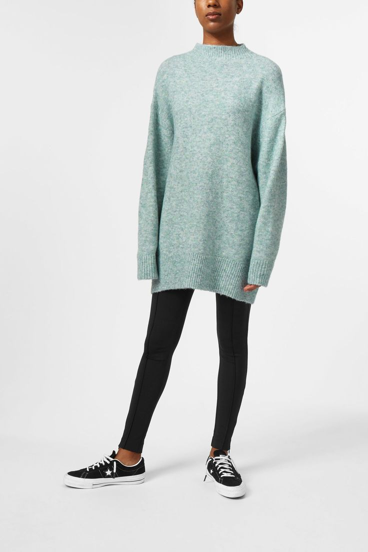 <p>The Berry Knit Sweater is an ultra soft oversized sweater with a fine mélange structure. It has a wide turtleneck, dropped shoulders, raglan sleeves and