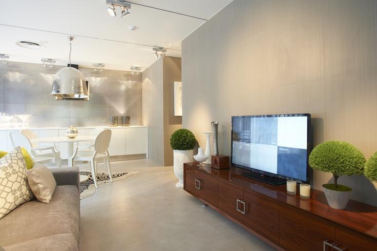 Lovetiles Showroom Lisbon, white round table, zebra rug, white chairs, grey sofa, geometric pillows