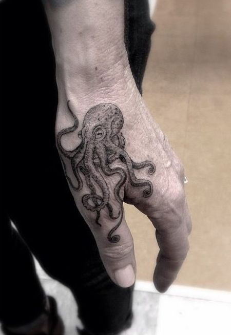 http://tattooideas247.com/octopus/ Octopus Hand Tattoo #Fingers, #Hand, #Octopus