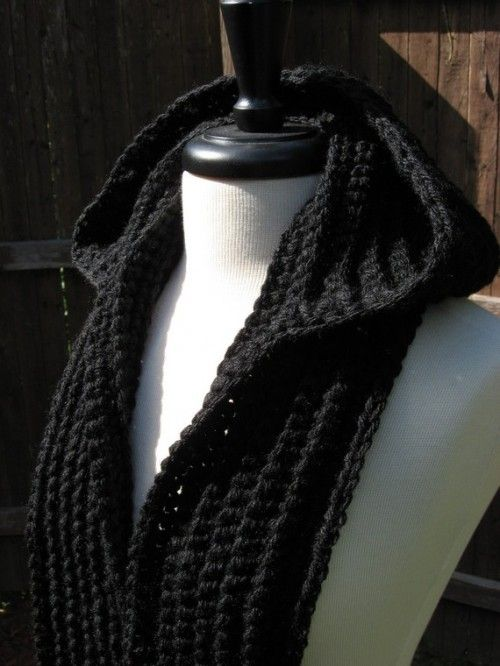 classy hooded scarf which is available in jet black as well as Nordic White and is made bynutsaboutknitting