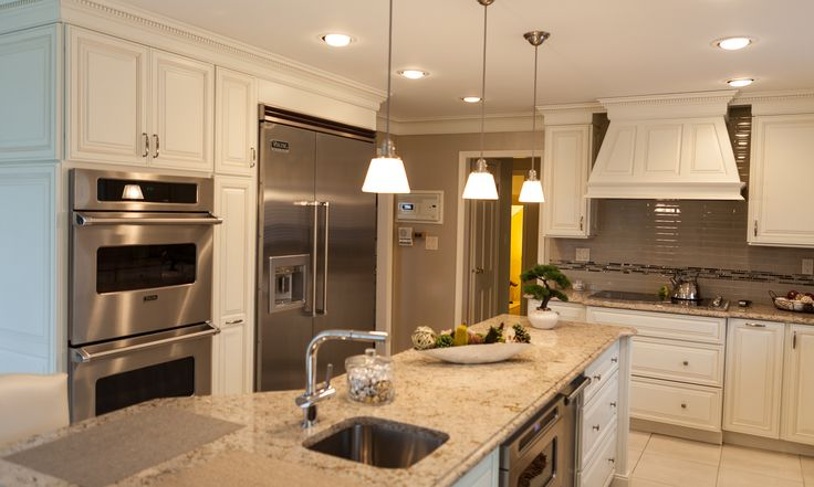 Island with service sink adds an additional prep area in this kitchen.