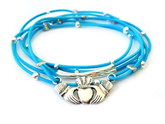 Claddagh Bracelet Set Blue and Sterling Silver by WristBliss  The claddagh is an Irish symbol for love and friendship. This bracelet set would make a wonderful gift for a friend or loved one.  It is made with a silver claddagh charm, small tubes, and crimp beads on blue stretch cord.  #jewelry #fashion #accessories #claddagh #irish #ireland