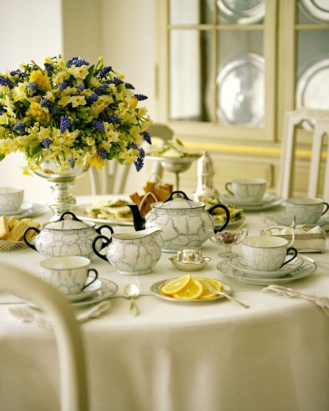 The yellow & blue flowers & pretty china make such a sweet setting.
