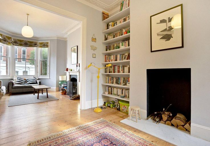 Light grey walls - knocked through sitting room dining room with built in bookshelves