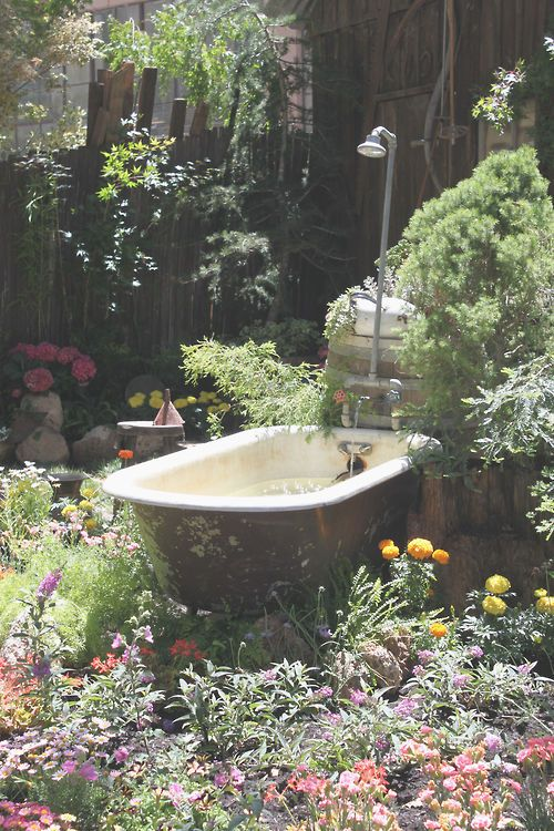 My grandparents had bathtubs as watering troughs on their property for their horses, I love this idea