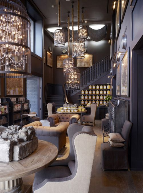 Bird cages over chandeliers, grey tufted wingbacks
