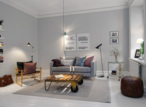 I like the grey walls and the floor. The decor is just too magazine perfect for me :)