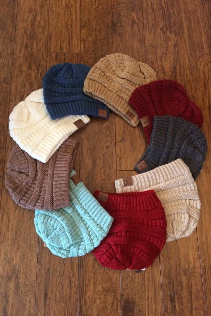 Your Fall and Winter wardrobe can't be complete without the popular cableknit CC Beanie.