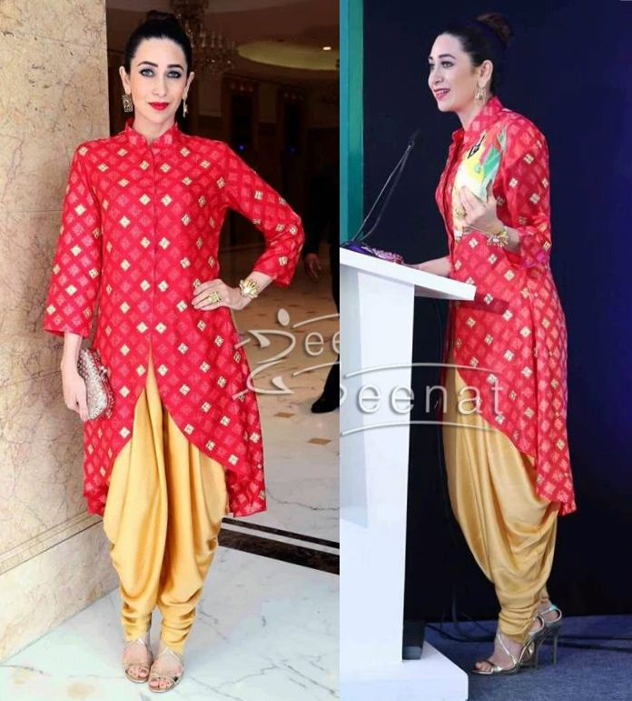 Karisma Kapoor in Swati Vijaivargie's red kurta and yellow dhoti pants.