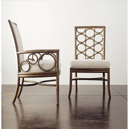 Laura Kirar Upholstered Arm Chair and Dining Side Chair from McGuire