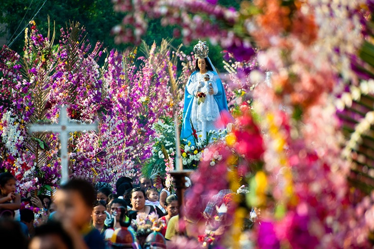 An altar with a statue of Virgin Mary is carried during the procession of the Flower & Palm Festival in Panchimalco, El Salvador.