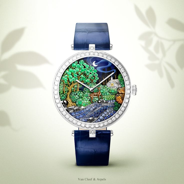 Watches&Wonders 2015 - The Poetry of Time™ by Van Cleef & Arpels. Lady Arpels Peau d'Âne Forêt enchantée watch - white and yellow gold, diamonds, sapphire, emeralds, tsavorite garnets and spessartite garnets.
