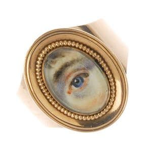 LOT:5 | A late Georgian gold mourning miniature portrait lover's-eye ring, circa 1800.