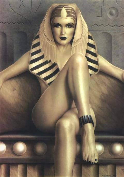 Gold covered Egyptian queen. eye liner. colored lips. contoured cheeks.