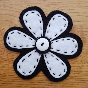 black and white felt with button.