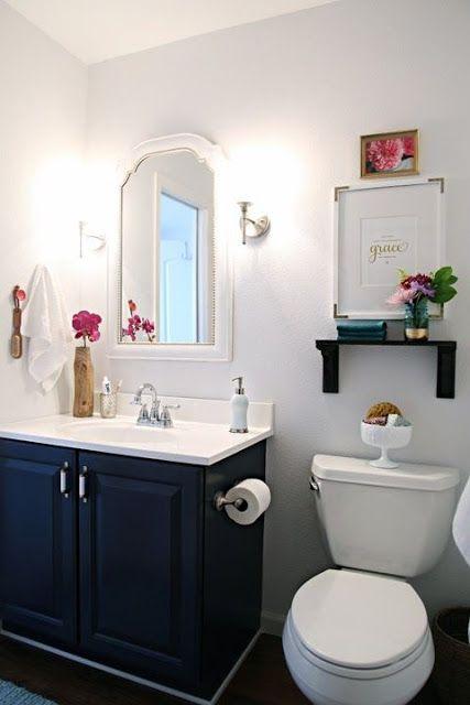 bathroom makeover via I Heart Organizing-- painted vanity, shelf above toilet, framed mirror,  simple decor