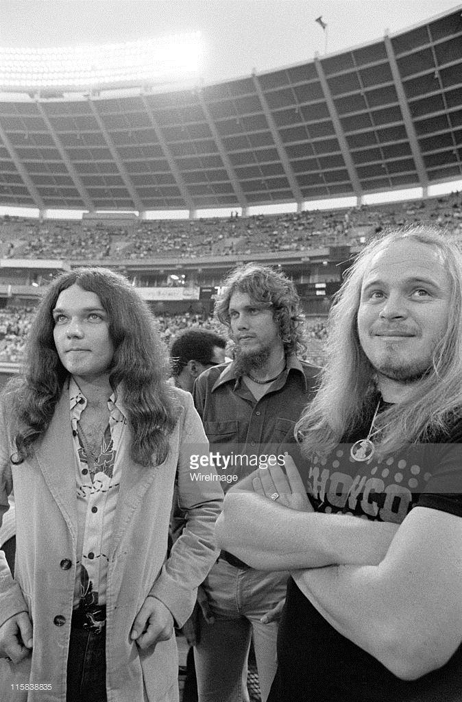 Gary Rossington, Steve Gaines and Ronnie Van Zant of Lynyrd Skynyrd, on the field before the Season Opening Atlanta Braves Game
