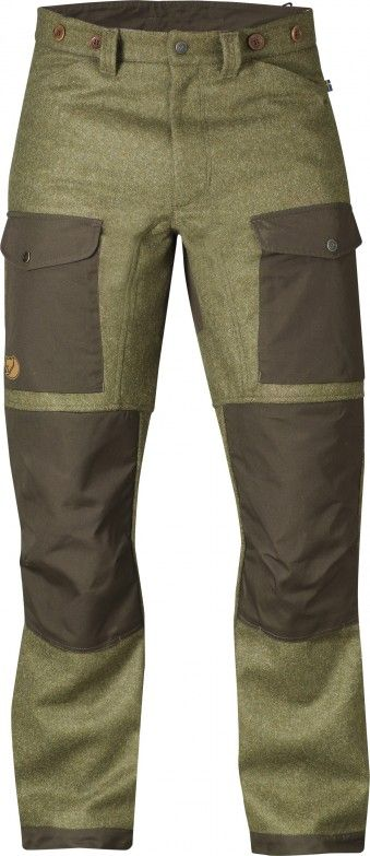 Fjallraven Forest Trousers - Robust and well-equipped hunting trousers in exclusive Shetland wool from Abraham Moon. Exposed areas at the knees back and leg endings are reinforced with G-1000 HeavyDuty that can be waxed for enhanced durability.