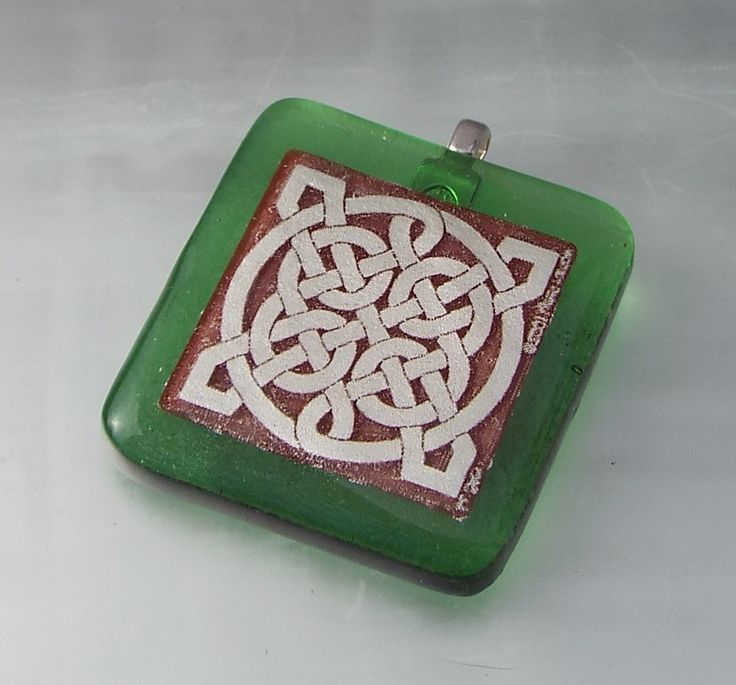 An irridized green background and a hand painted silver Celtic…