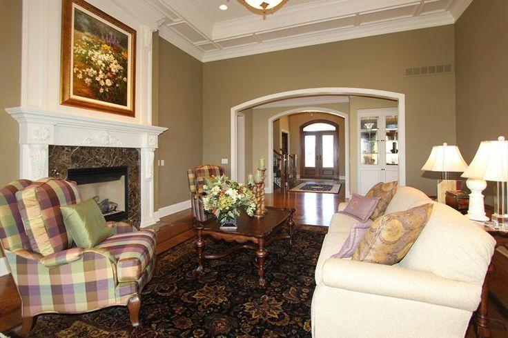 8665 Emerald Isle Deerfield Twp., OH 45040 #moldings, #fireplace, #plaid chair, #neutralpaint, #livingroom