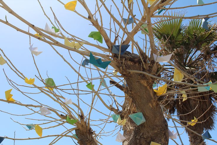 Colored paper boats tree