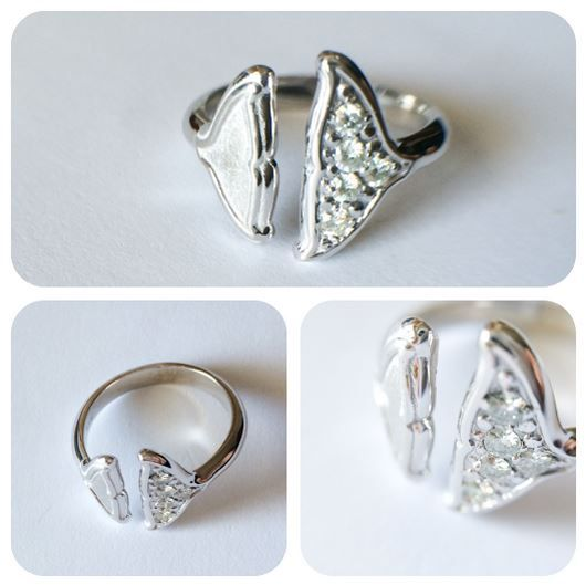 Moissanite and white gold whale inspired ring.