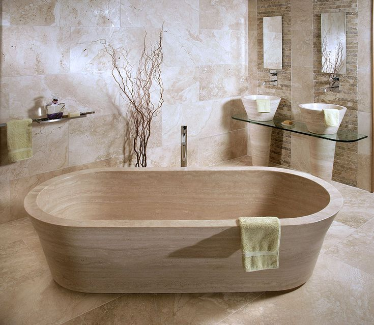 "Pietre di Rapolano solid stone bathtub featuring the same contours as the ""Cono"" sink design. Simple yet elegant. by Pietre di Rapolano"
