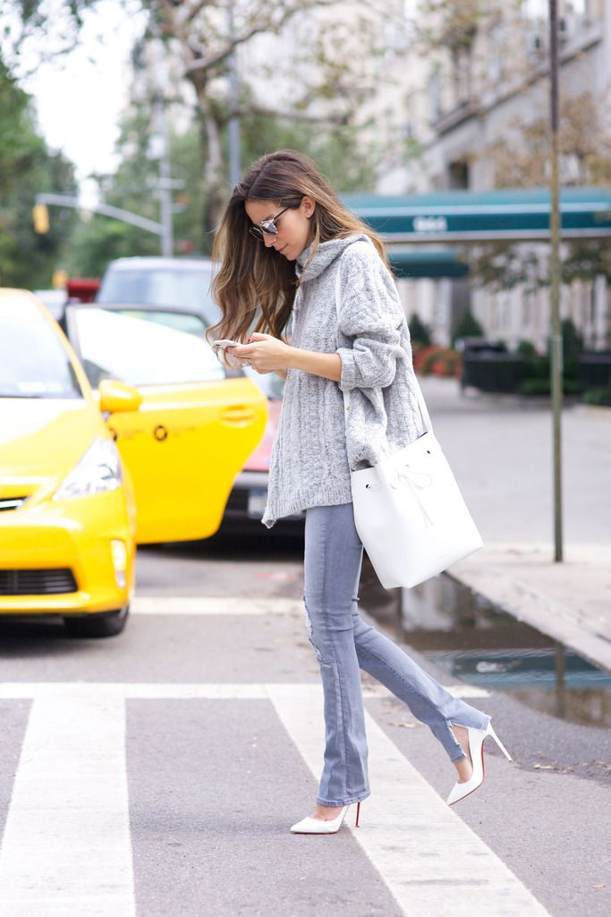 Arielle Nachamipairs this cute grey knit sweater with pastel colouored jeans and white heels.Jeans: J Brand, Sweater: NastyGal, Shoes: Christian Louboutin.