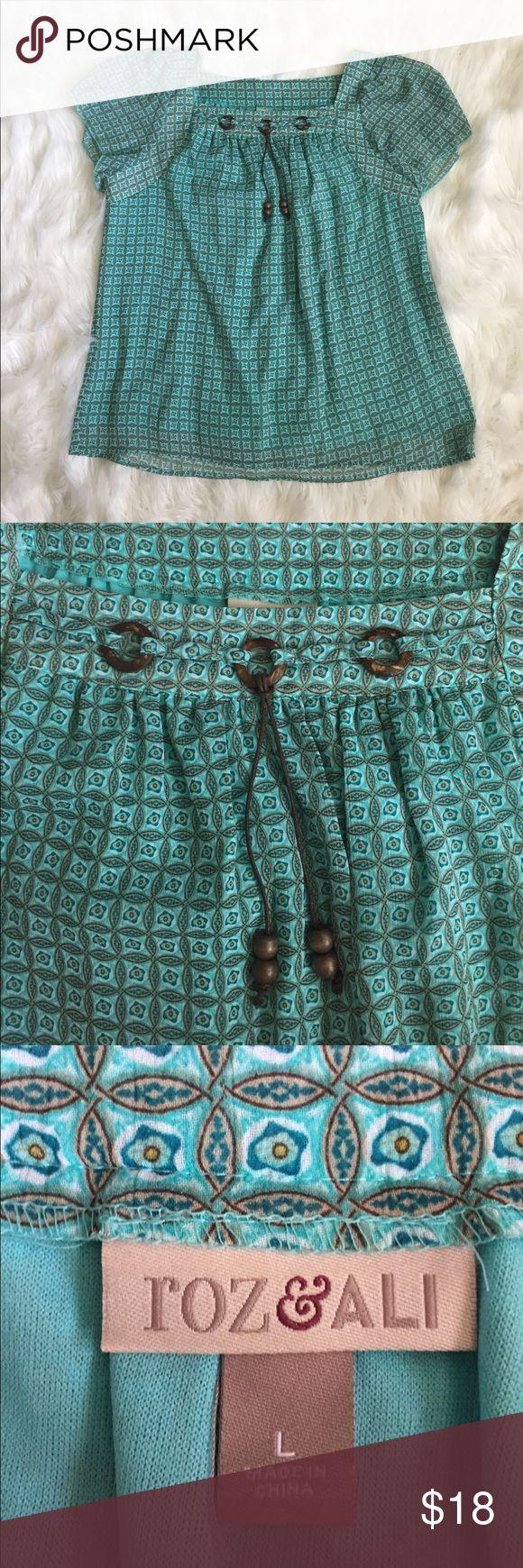 Roz & Ali teal top Roz & Ali teal top with brown wood details Roz & Ali Tops Tees - Short Sleeve