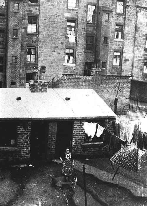 Tenement Back Court with wash house, Glasgow, Scotland - Each wife in the building had a 'wash day' when they could use the wash house (not all did, as if you were a little better off (or were thrifty) you could send your washing to the laundry. Big job - had to light a fire (and keep it lit) under the boiler and wait for it to heat and boil your clothes in it then hang them out after reboiling more water to rinse them. People nowadays don't realize how much work it was to live back then.