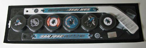 """San Jose Sharks Mini Hockey Stick Foam Puck Play Set by NHL. $19.99. San Jose Sharks hockey stick and puck play set. Set contains two plastic hockey sticks decorated in team logos/colors and 6 foam pucks.  The mini sticks measure about 18"""" long. Fun for kids and adults alike. Officially licensed by the NHL. New in package. A fun item for the Sharks fan/collector. Makes a great gift!"""
