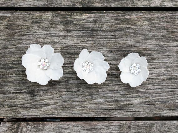 White bridal flower pins, bridal hair accessories, wedding headpiece, wedding hair accessories, floral hair accessories  Flowers are made entirely by hands from cold porcelain.  Price for one piece.   You can ask me any questions and I will certainly answer you. Each piece is unique and slightly different to one another. I love custom order and love to hear from you. Other colors are available. Custom orders are welcomed. When the order is ready I will send a picture to you for your…